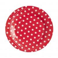 Rouges assiettes en papier rondes avec des pois blancs